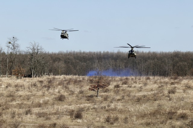 Helicopters from 2-3 General Support Battalion, 3rd Combat Aviation Brigade, 3rd Infantry Division, fly towards the landing zone during Hawk Strike in Hungary on March 5. Hawk Strike allows units to conduct movements in a realistic, high-intensity environment to ensure readiness and the ability to fully integrate with any NATO partner and ally, such as the Hungarian Forces.