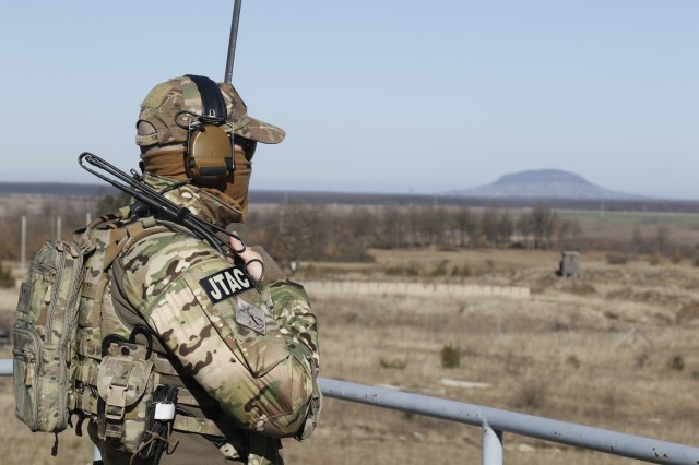 A Soldier from the Hungarian 2nd Special Operations Forces conducts a radio check during Hawk Strike in Hungary on March 5. Hawk Strike allows units to conduct movements in a realistic, high-intensity environment to ensure readiness and the ability to fully integrate with any NATO partner and ally, such as the Hungarian Forces.