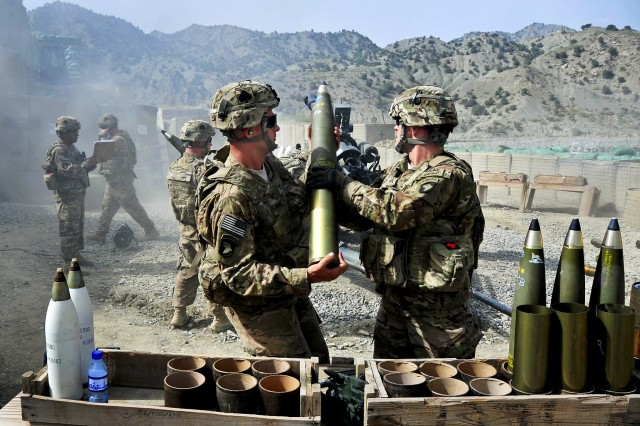 U.S. Soldiers prepare a round for a fire support mission using an M119 105mm howitzer on Combat Outpost Wilderness, Paktya province, Afghanistan, Aug. 15, 2013.