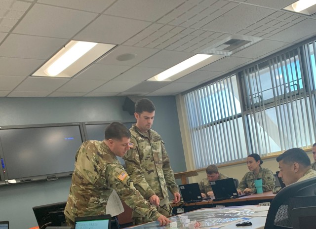 BSNCOC redesign and validation underway Sgt. 1st Class Ryan Krisrow (left) and Sgt. Keenan Hoeft (right), perform a Combined Arms Rehearsal briefing to fellow participants of the BSNCOC 10-20, students of the course graduated March 21.