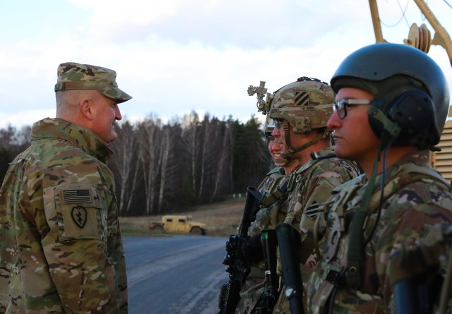 Col. Timothy O'Connor (left), 1st Infantry Division Forward Commander, speaks to Soldiers from Alpha Company, 9th Brigade Engineer Battalion, 2nd Brigade Combat Team, during a base tour at Ziemsko Airfield, Poland, on March 11, 2020. U.S. and Polish officials took a tour as a part of DEFENDER-Europe 20.