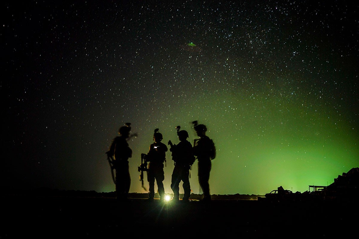 U.S. Army Soldiers from Easy Company, 101st Airborne Division (Air Assault), stand by for their night guard shift in Kenya, Jan. 20, 2020. Soldiers from the 101st Airborne Division are assigned to the East Africa Response Force and provide the ability to rapidly respond to events spanning a vast area of responsibility.
