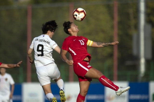 1st Lt. Hanna Rozzi heads a ball during a match with South Korea in the 2019 CISM Military World Games in Wuhan, China Oct. 19, 2019. Rozzi served as platoon leader for the 2nd Battalion, 8th Cavalry Regiment, 1st Armored Brigade Combat Team, 1st Cavalry Division at Fort Hood, Team. She recently served as military aide to Maj. Gen. Scott Efflandt, now the deputy commanding general of III Corps at Fort Hood, Texas.