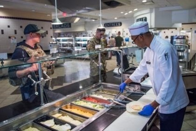 A Soldier with the 3d U.S. Infantry Regiment (The Old Guard) prepares a sandwich at the dining facility, DFAC, on Joint Base Myer - Henderson Hall as part of the shift to a grab-and-go serve system, March 19, 2020. The shift is part of the DFAC's implemented changes to combat COVID-19.