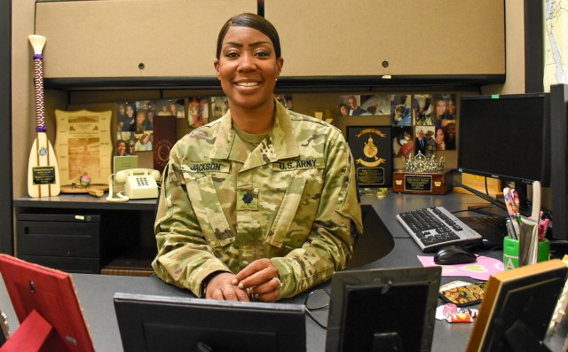 Lt. Col. Erica D. Jackson, 32d Army Air and Missile Defense Command plans officer, poses in her office March 20, 2020.