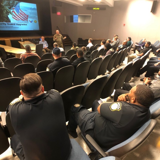 Fort Stewart Department of the Army security guards are briefed by garrison leadership about changes to the force structure during a town hall at Moon Theater, Feb. 18.