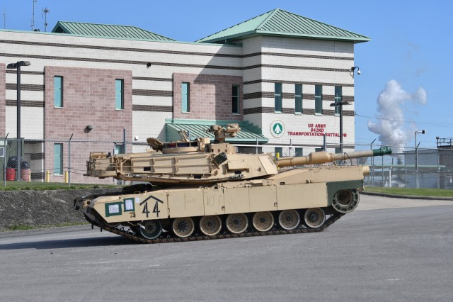 A 2nd Armored Brigade Combat Team, 1st Armored Division A1 Abrams tank rolls by the 842nd Transportation Battalion February 22, 2020 on its way to the M/V Resolve, docked at the Port of Beaumont. This tank and more than 2,600 pieces of equipment from Fort Bliss, Texas are being processed by the 842nd Transportation Battalion before heading to the European theater in support of DEFENDER-Europe 20. (U.S. Army photo/Kimberly Spinner)