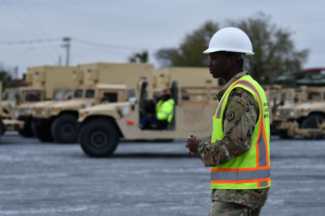 Spc. Dim Cabore, 842nd Transportation Battalion cargo specialist, prepares to mark a vehicle in a staging yard outside the Port of Port Arthur, Texas with stow plan info. The vehicle is one of many heading to Europe via ship in support of DEFENDER-Europe 20.