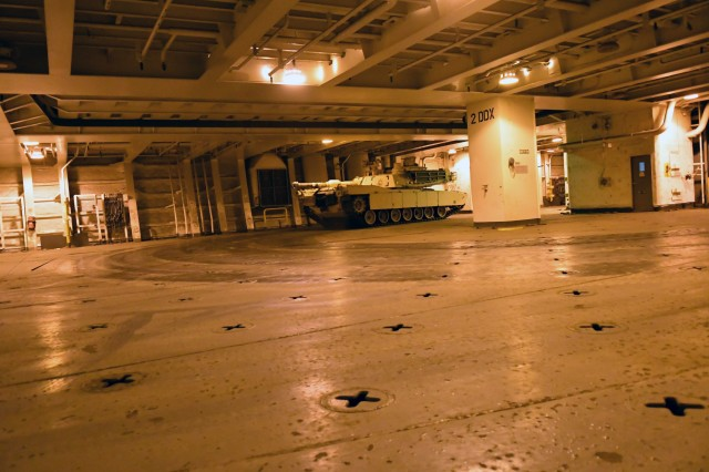 An A1 Abrams tank navigates through the decks of the Bob Hope-class roll-on/roll-off ship USNS Benavidez February 22, 2020 in support of DEFENDER-Europe 20. The ship will carry military equipment to the European theater as part of almost 6,000 pieces of cargo that the Military Surface Deployment and Distribution Command will process through ports in the Gulf of Mexico. (U.S. Army photo/Kimberly Spinner)