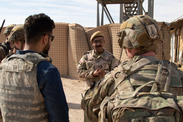 U.S. Soldiers with 1st Battalion, 5th Infantry Regiment, 1st Stryker Brigade Combat Team, 25th Infantry Division, greet Iraqi troops guarding the perimeter of Al Asad Airbase in western Iraq, Feb. 15, 2020. Al Asad is the largest military airbase in Iraq and the second-largest in the U.S. Central Command area of responsibility. Iraqi and coalition troops share responsibility for the security of the base. (U.S. Army photo by Sgt. Sean Harding)