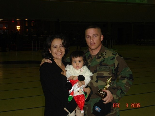 Ursula Palmer poses with her late husband then-Staff Sgt. Collin Bowen and daughter Gabriela, in 2005.
