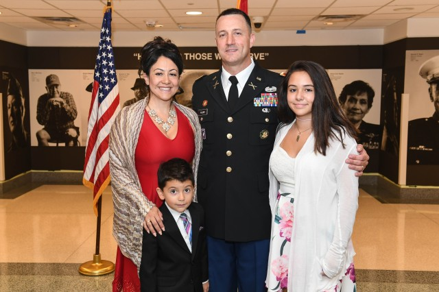 Ursula Palmer poses for a photo with her husband, Col. Timothy Palmer, and son and daughter, Ian and Gabriela, during Timothy's promotion ceremony at the Pentagon in Arlington, Va., Sept. 6, 2017. As a Gold Star wife, Ursula persevered through the pain of losing her previous husband, Sgt. 1st Class Collin Bowen on March 14th, 2008.