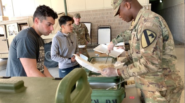 """For the Soldiers who are quarantined in the barracks, each battalion has set up """"feeding sites"""" where Soldiers who are able to leave their rooms can get food and also makes it easier for the ones who cannot leave their rooms to get a hot to go plate, delivered by the teams responsible to make sure Soldier's basic needs are being met."""
