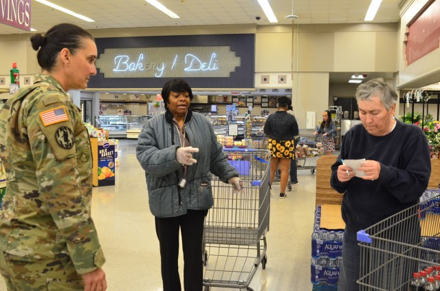 Command Sgt. Maj. Rebecca Myers, Fort Stewart Garrison's senior enlisted leader, speaks with a Fort Stewart Commissary employee and customer on Fort Stewart, Georgia., April 3, 2020. Myers visits several places on the installation every day to ensure operations are running smooth and to get an update on how people in the Marne community are doing. (U.S. Army photo by Sgt. Zoe Garbarino)