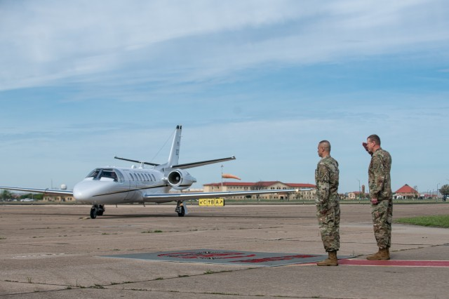 Fort Sill's Commanding General Ken L. Kamper and Command Sgt. Maj. John W. Foley, wait at the Henry Post Army Airfield at Fort Sill, OK, for the arrival of Gen. Paul E. Funk II, the commander of the U.S. Army Training and Doctrine Command on April 7, 2020. Funk visited Fort Sill to meet with leadership throughout Fort Sill and assess the measures in place to prevent the spread of COVID-19. (U.S. Army photo by Sgt. Dustin D. Biven / 75th Field Artillery Brigade)