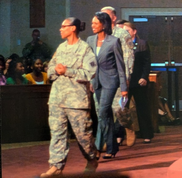 Chief Warrant Officer Yolondria Dixon-Carter escorts former Secretary of State Condoleeza Rice, guest speaker at a Women's Equality Day observance for the 3rd Infantry Division, at Fort Stewart, Ga., Sept. 8, 2009. Dixon-Carter organized the event and arranged for Rice to spend an hour mentoring young female students.