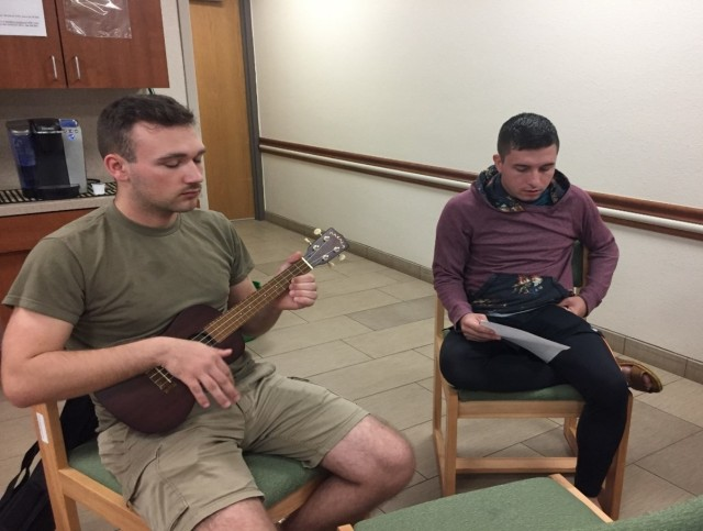 Pfc. Zachary Tucker (left) plays the ukulele while Spc. Quinn Mazepa looks over the music and prepares to sing during a Kanikapila at the Schofield Barracks Warrior Transition Battalion (U.S. Army Courtesy Photo)