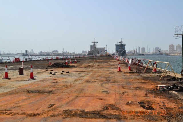 Photos of the old naval pier at Naval Support Activity Bahrain during the demolition phase of a U.S. Army Corps of Engineers Middle East District project to construct a new steel and concrete pier.