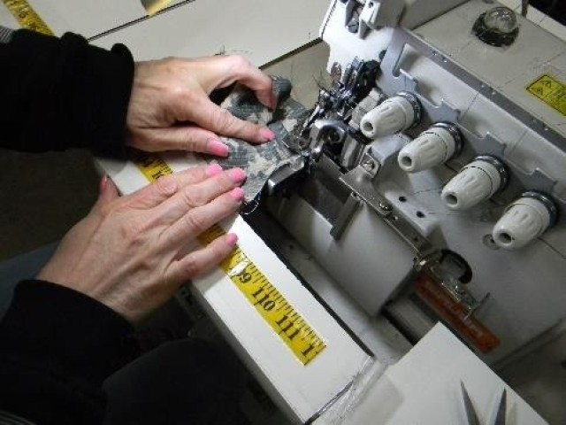 To produce the face masks, Pine Bluff Arsenal personnel are using a specialized cutter (for cutting accuracy and efficiency), a serger with safety stitch capabilities (for added stitch strength) and light-duty sewing machines.