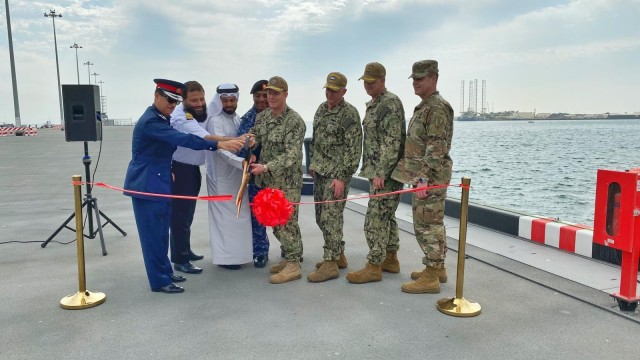 Capt. Greg Smith, commanding officer of Naval Support Activity (NSA) Bahrain, cuts a ribbon with senior American and Bahraini leaders to celebrate the opening of the renovated Mina Salman Pier. NSA Bahrain enables the forward operations and responsiveness of U.S. and allied forces in support of Navy Region Europe, Africa, Central's mission to provide services to the fleet, warfighter and family.