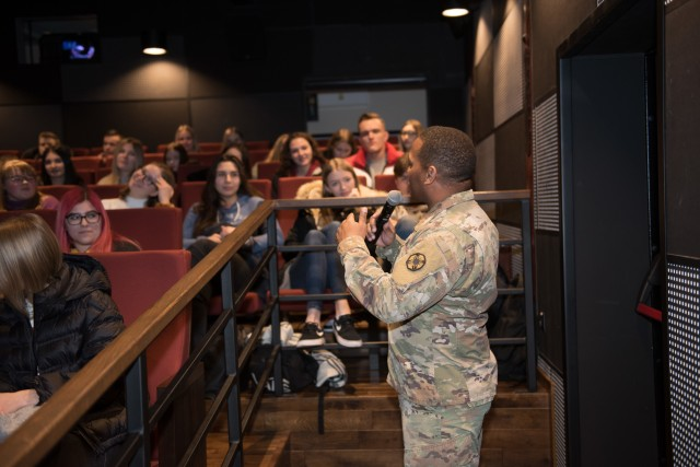 Staff Sgt. Antonio Webster, Headquarters and Headquarters Company, 13th Expeditionary Sustainment Command, answers questions for students in attendance during a community outreach event March 9.  Community outreach events help local communities and host nations gain an increased understanding of the Army, its mission and gain familiarity with the Soldiers who are the face of the Army.   (U.S. Army photos by Sgt. 1st Class Kelvin Ringold)