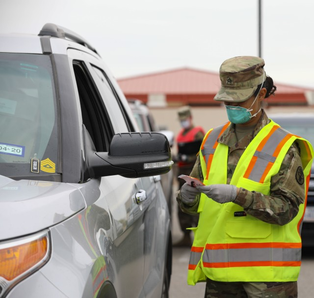 A U.S. Army Pharmacy Specialist dispenses patient's prescriptions at the William Beaumont Army Medical Center (WBAMC) curbside pharmacy service on Fort Bliss, Texas, April 6, 2020. WBAMC has implemented the new curbside pharmacy service as an additional health protection measure to help mitigate the spread of COVID-19, enabling Fort Bliss to better preserve the health and well-being of beneficiaries, staff and the El Paso community. (U.S. Army photo by: Staff Sgt. Michael L. K. West)