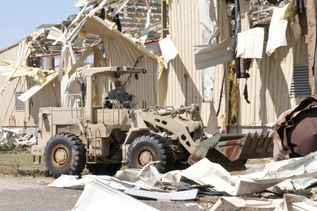 A Soldier with the 307th Engineer Battalion, moves debris with a bulldozer on Fort Bragg Monday, April 18 as part of the Directorate of Public Works' effort to clean up areas hit by a tornado, which struck Fayetteville and the southern edge of Fort Bragg Saturday, April 16. Photo by Michelle Butzgy/Paraglide