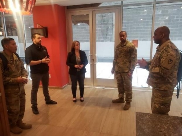 From right, Lt. Col. Jason Miles, Maj. Jermaine Pruitt and Master Sgt. Cirildo Guerrero Jr., explain the requirement for lodging to the staff at a New York City area hotel. Miles and Pruitt are deployed to New York City to provide contracting support to Soldiers from the 3rd Expeditionary Sustainment Command there for the nation's fight against the COVID-19 pandemic. Miles is the commander of Regional Contracting Center-East Contracting Support. Pruitt is the deputy commander of RCC-East Contracting Support. Guerrero is the 3rd Expeditionary Sustainment Command operational contract support integration cell noncommissioned officer in charge.
