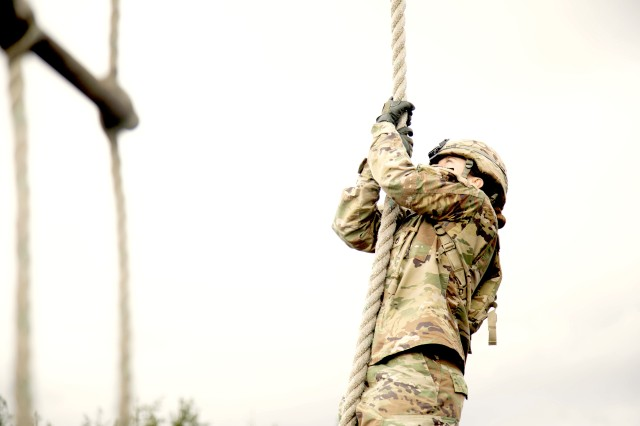 Staff Sgt. Erica Myers climbs a rope during 5th Security Force Assistance Brigade's Assessment and Selection process, Jan. 28, 2020 at Joint Base Lewis McChord, Washington.  The SFAB Assessment and Selection process is a series of rigorous physical and mental tests designed to enable only the best candidates the chance to serve as an Advisor in the SFAB.