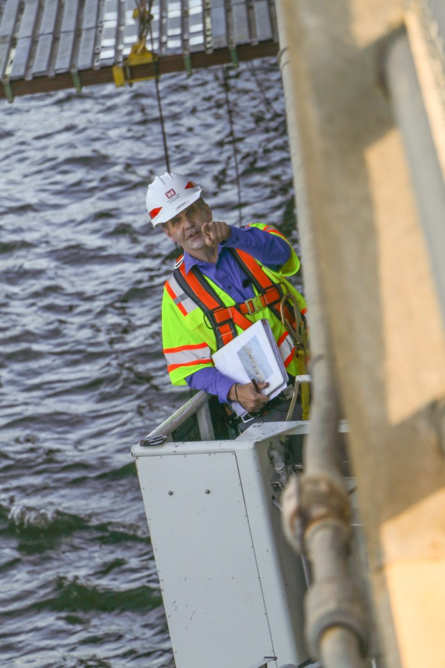 Lyle Peterson, civil engineer, U.S. Army Corps of Engineers, Omaha District, uses a snooper Sept. 23, 2019, to inspect the underside of one of the bridges spanning the Missouri River at the Big Bend Dam near Fort Thompson, S.D.
