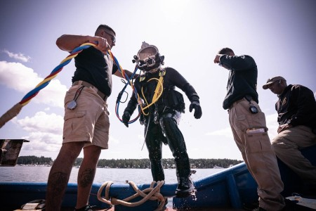 U.S. Army Sgt. Stephanie Johnson, 569th Engineer Dive Detachment, 53rd Engineer Battalion, 7th Transportation Brigade (Expeditionary) lead salvage diver, exits out of the water after a dive operation in Washington's Puget Sound, July 18, 2019. Army divers train in the principles of scuba and surface-supplied diving, underwater welding and cutting, use and care of hand and power tools, maintenance of diving equipment and explosives.