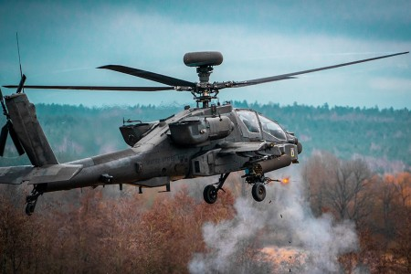 An AH-64 Apache engages targets downrange with its 30mm cannon during aerial gunnery tables on March 4, 2020.