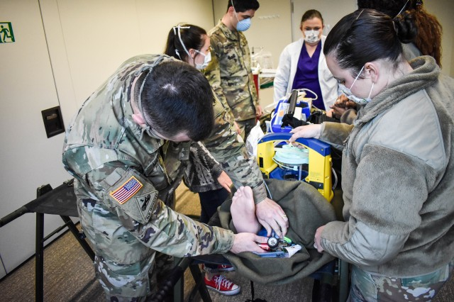 Soldiers and civilian personnel with the Ansbach Army Health Clinic simulate patient packaging and transport during the U.S. Army Medical Department Activity Bavaria COVID-19 Contingency Training at the Ansbach Army Health Clinic on Urlas Kaserne April 15-17.