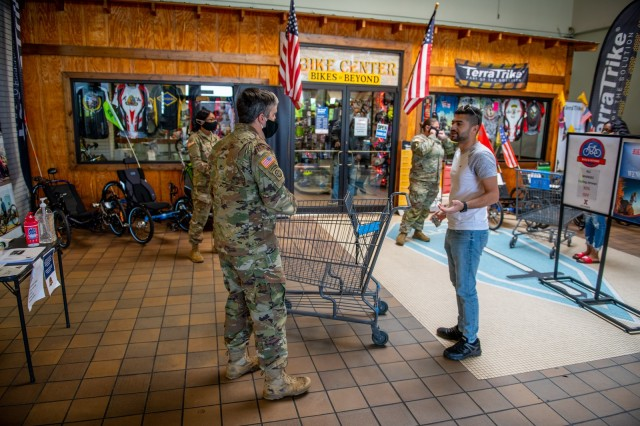 FORT BENNING, Ga. – Soldiers assigned to courtesy patrol duty at the Fort Benning commissary April 15 check would-be shoppers for proper identification cards and for whether they are wearing face masks or other face coverings, a recent requirement at Department of Defense facilities as a precaution against the spread of COVID-19.