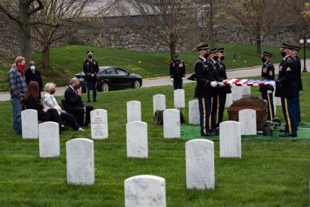 Soldiers assigned to 1st Battalion, 3d U.S. Infantry Regiment (The Old Guard) conduct military funeral honors for U.S. Army Retired Command Sgt. Maj. Robert M. Belch in Section 68 of Arlington National Cemetery, Arlington, Virginia, April 14, 2020. Given current health protection guidance from the Secretary of Defense, Old Guard Soldiers wear face coverings to mitigate the spread of COVID-19 while executing the Memorial Affairs mission.