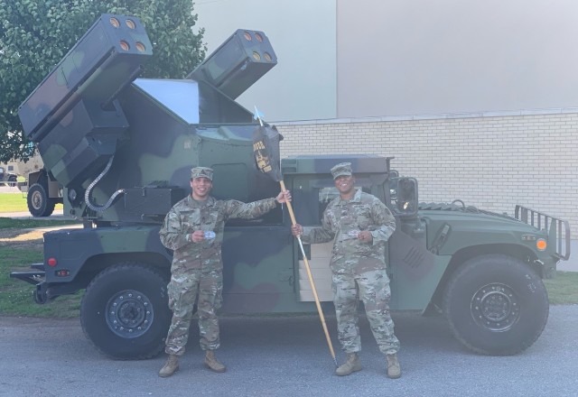 Staff Sgt. Lewis Washington (left) from Bravo Battery, 5th Battalion, 4th Air Defense Artillery Regiment, 10th Army Air and Missile Defense Command, and Staff Sgt. Tiana Trent from Charlie Battery, 5-4 ADAR, stands in front of an Avenger as they celebrate graduating from the Army Avenger Master Gunners Course. The two Soldiers graduated from the 35-day course in Ft. Sill, Ok. on April 16, 2020. Additionally, Trent is the first African-American female Graduate in the history of the Avenger Master Gunner Course. (photo by Staff Sgt.Keith Murphy, US Army)