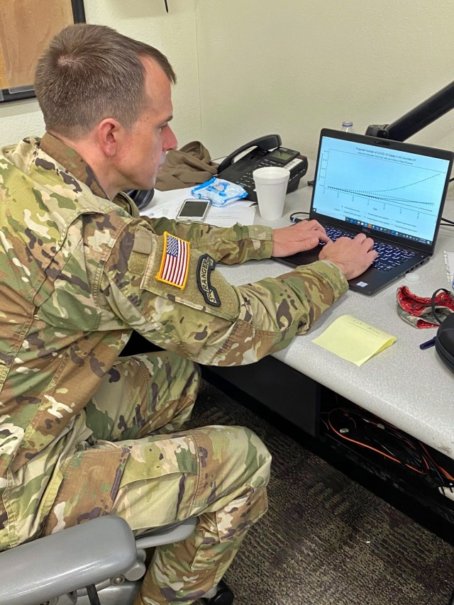 Lt. Col. Nick Clark, an assistant professor in the department of mathematical sciences, working on a mathematical model forecasting the impact of COVID-19 as part of his work augmenting Army North's response to the pandemic.