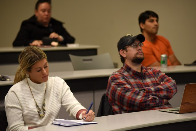 Middle Tennessee State University students listen and take notes as U.S. Army Corps of Engineers Nashville District Real Estate Division officials speak during the Guaranty Trust Real Estate Speaker Series Nov. 7, 2018 on campus at the Business and Aerospace Building.