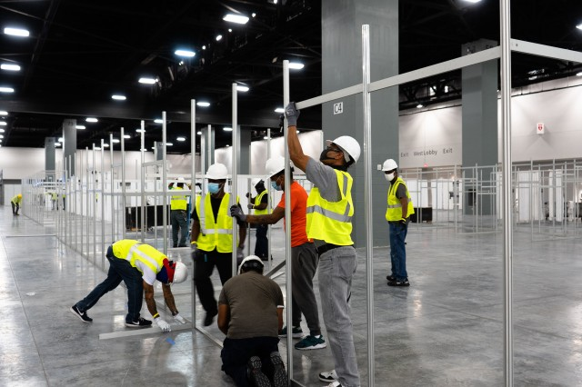 The Miami Beach Convention Center is now a 24 hour construction site crews work at a steady pace to install ICU and Acute Care pods.  USACE staff awarded a construction contract Monday April 6, 2020 for $22.5 Million to Robins & Morton of Miami, Fla. to convert the Miami Beach Convention Center into a 450-bed hospital.
