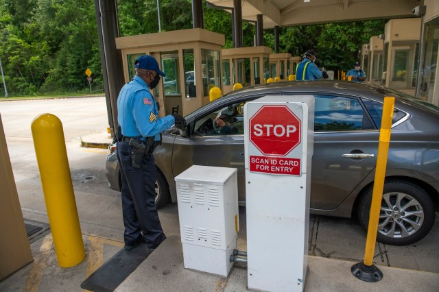 FORT BENNING, Ga. – At Fort Benning's main gate April 24, security guards check for proper identification of motorists seeking entry to the post. To minimize the spread of COVID-19, officials in March banned most visits, including those for social, recreational or entertainment purposes, but are also okaying requests for certain other visits they deem appropriate.