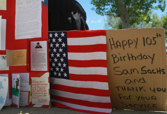 Birthday cards are displayed in the driveway and in front of the home of World War II veteran, Lt. Col. Sam Sachs, wishing him a happy 105th birthday, in Lakewood, Calif. on April 26, 2020.  The retired Army officer's birthday was celebrated with a parade and a social distancing celebration.