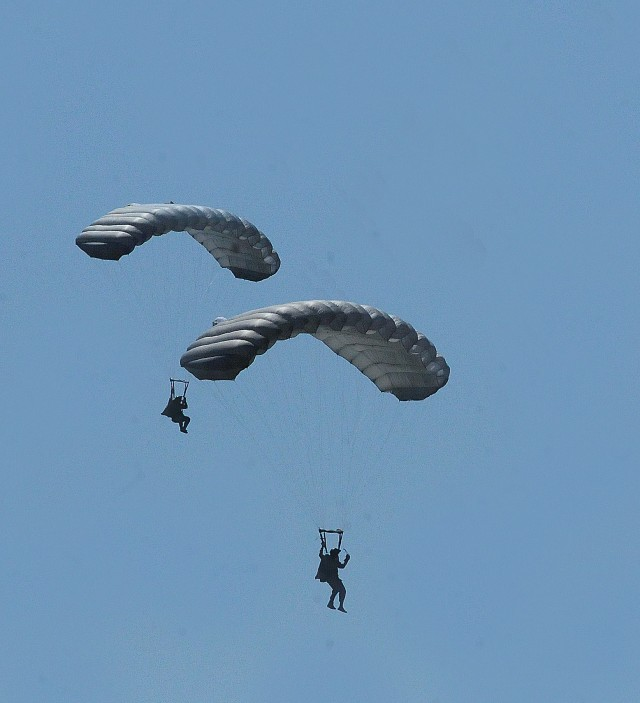 Quartermaster School cadre descend from the sky during a April 22 airborne operation at Fort Pickett's Blackstone Army Airfield.
