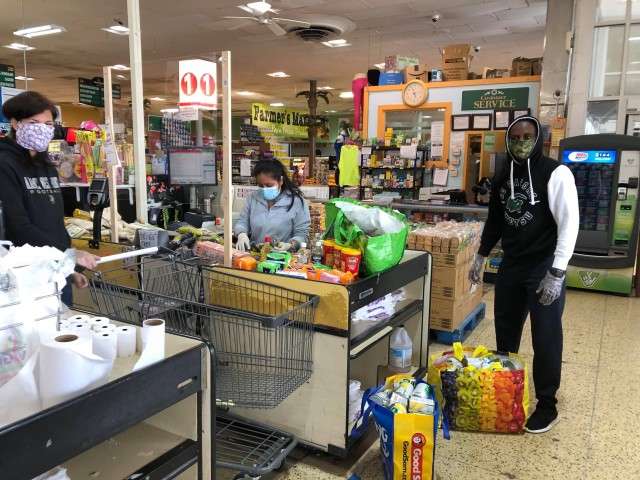Class of 2023 Cadet Ruganzu Divin Mulisa from Rwanda helps bag groceries that were bought to help community families who lost their jobs.