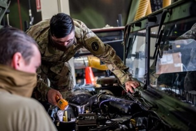 Soldiers with the 3d U.S. Infantry Regiment (The Old Guard) conduct maintenance on a vehicle on Joint Base Myer - Henderson Hall, Virginia, April 21, 2020. Given the current health protection guidance from the Secretary of Defense, Old Guard Soldiers wear face coverings to mitigate the spread of COVID-19 while executing their missions.
