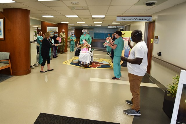 COVID-19 Patient is celebrated before heading home.