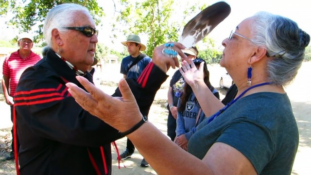 Members of the Xolon Salinan tribe participate in a smudging purification ceremony before they visit Stony Valley, located on Fort Hunter Liggett, in June 2018. Tribal member Bobby Sims uses an eagle feather to waft the sage smoke onto Donna Haro, tribal headwoman. Fort Hunter Liggett maintains positive relationships with the local community and works together with all stakeholders in support of our shared goals.