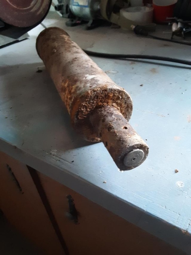 Inert Stokes mortar round found and picked up by a landowner on the Livingston Target Range cleanup site.  Establishing a relationship with landowners is the key to educating them about the potential risks of UXO and getting their permission to perform cleanup on their property.