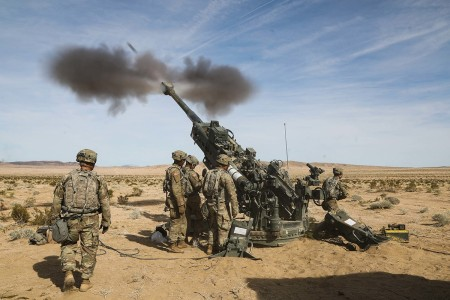 U.S. Army Soldiers fire an artillery round from an M777 Howitzer while conducting calibration at the National Training Center in Fort Irwin, Calif., March 05, 2020.