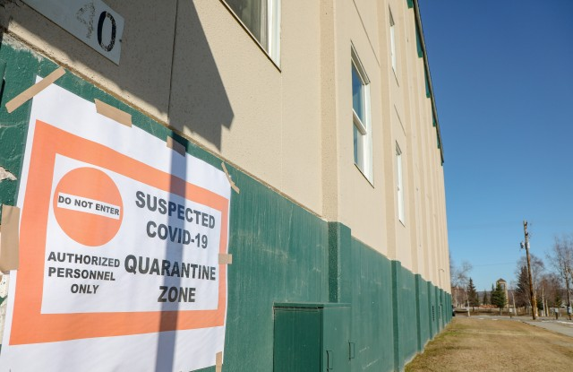 The sign that greats people as they enter building 3440 on Fort Wainwright to warn them they are entering a quarantine zone 24 April, 2020. Building 3440 and 3448 have been set aside to house service members who need to be quarantined according to public health. (US Army photo provided by Sgt. Christopher B. Dennis)