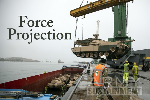 Cpl. Dustin Jobe, noncommissioned officer in charge of lifting provisions, 647th Expeditionary Terminal Operations Element, U.S. Army Reserves, supervises the lifting of an M1A2 Abrams Tank assigned to 2nd Armored Brigade Combat Team, 1st Cavalry Division, over the pier ledge at the Port of Vlissingen, Netherlands, to be lowered onto a low-barge ship for transportation to another location within Europe, Oct. 12, 2019. (Photo by Sgt. Kyle Larsen.)